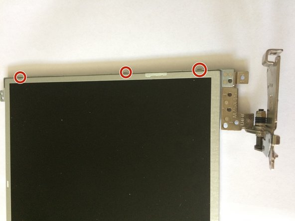 Using a Phillips 0 screwdriver, remove the 6 screws (M2 x 3) that secure the display hinges to the display panel.
