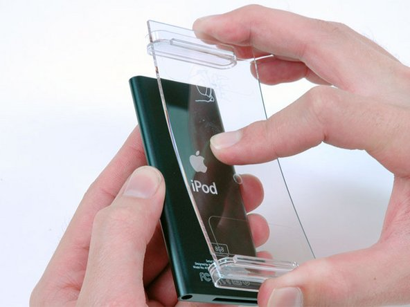 The new packaging is innovative. Plastic retainers hold the iPod on top and bottom, and you must flex the plastic packaging to get the iPod out.