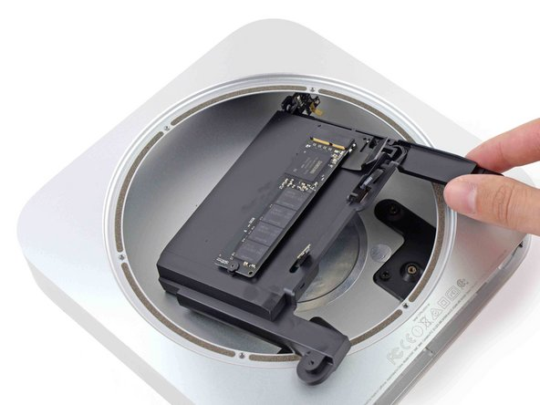 Lift the drive tray up out of the Mac mini.