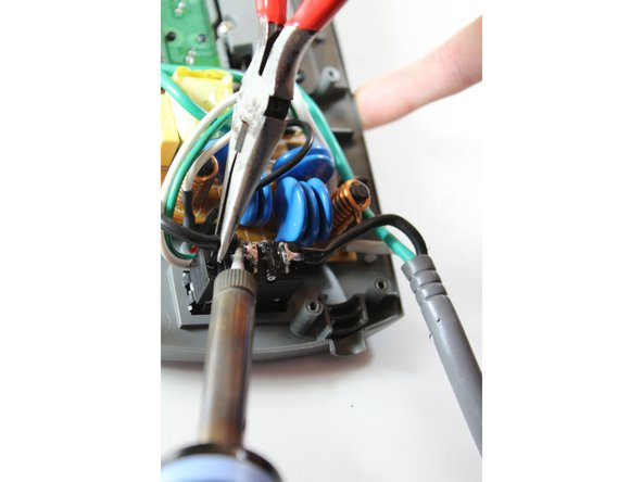 Locate the power switch leads and apply solder iron tip to wire 1.