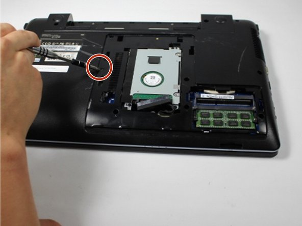 Remove the 4 mm Phillips #8 screw to the left of the hard drive using a Phillips #00 screwdriver.