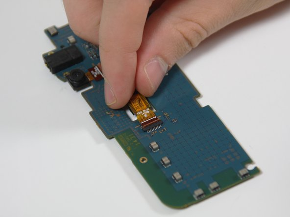 Use your fingers to grip the camera and carefully pull it out and away from the motherboard