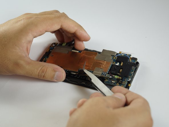 Lift the motherboard completely out of the phone with the tweezers. (may stay attached at the bottom by tape)