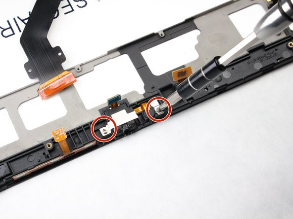 Using a Phillips #00 screwdriver, unscrew the 2 screws (3mm).
