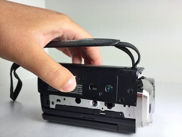 When the side cover is securely fastened, you have completed the Record Button replacement of your Panasonic HDC-TM15 camcorder.