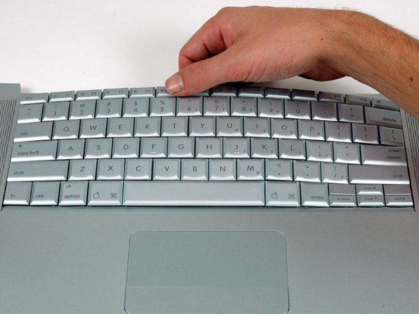 Image 1/1: Slide the keyboard away from the trackpad and out of the upper case.