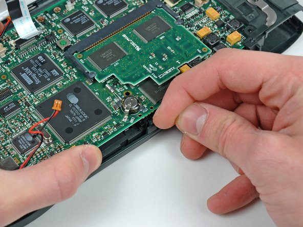 Removing the logic board from the Apple Tablet during the teardown