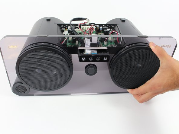 Remove the speaker covers by pulling them off of the faceplate.