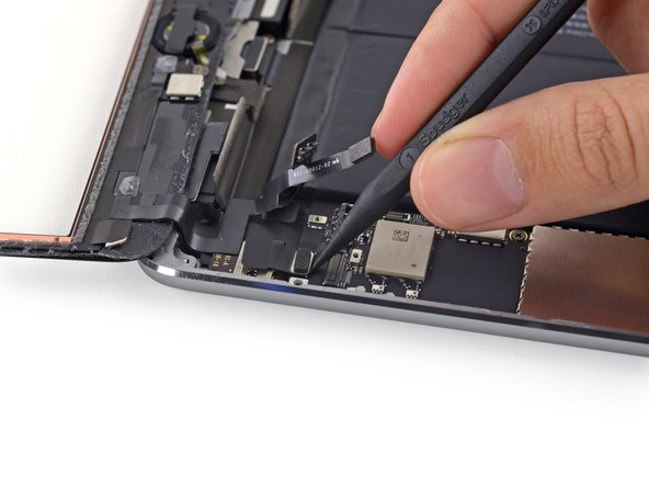 Use the tip of a spudger to lift the digitizer cable connector straight up off of its socket.