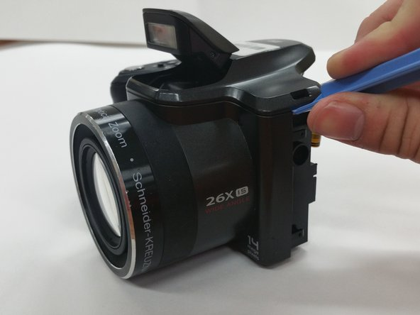 Image 1/2: Use the [product IF145-000 Plastic Opening Tool] to gently apply pressure on the top of the camera and remove the upper portion