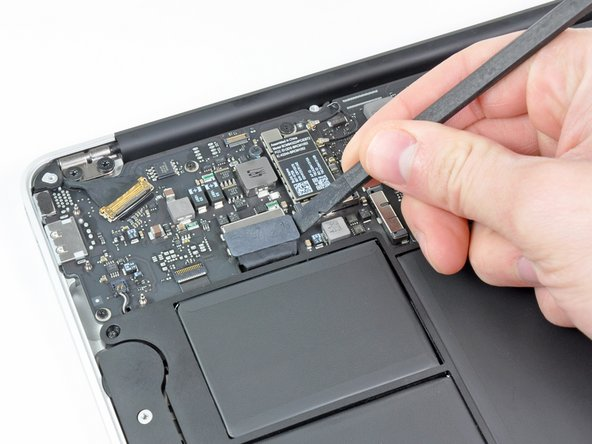 Bend the battery cable slightly away from the logic board so the connector will not accidentally contact its socket.