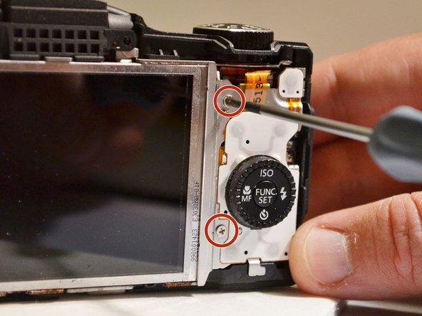 Using the Phillips 00 screwdriver, remove the two 3mm screws closest to the right of the LCD screen.
