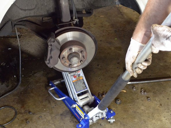 Place a jack underneath the ball joint to support it once you remove the 3  ball joint-to-control arm bolts.