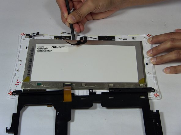 Image 1/2: Lift the frame up slowly and place it to the side.