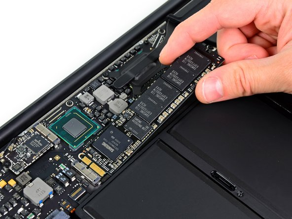 Slightly lift up the end of the SSD and pull it straight out of its socket on the logic board.