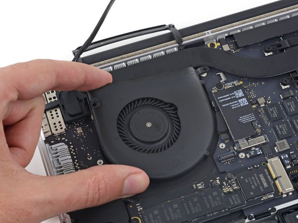 Lift the fan and push it gently towards the back edge of the MacBook to free the fan cable from its socket.