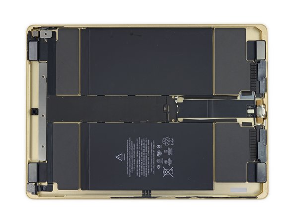 Image 1/2: A logic board relocation isn't the only easily-recognized layout difference between the iPad Pro and previous iPads. While the iPad Air 2's interior real estate was dominated by a [https://www.ifixit.com/Teardown/iPad+Air+2+Teardown/30592#s71659|proportionately massive battery|new_window=true], the iPad Pro dedicates a significant amount of room to speaker enclosures.