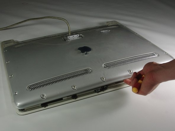 Image 3/3: Completely remove the back plate and set it aside.