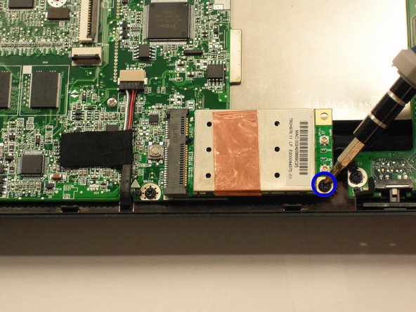 Image 1/1: Remove the the 3.9mm screw from the wifi card using Phillips #1 screwdriver.