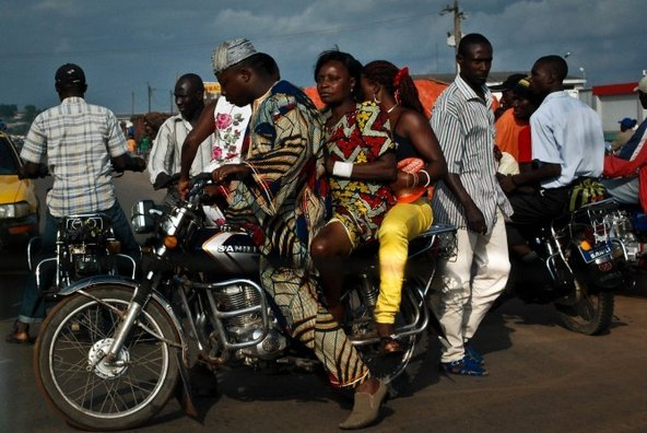 Motorcycle ride near a roadside repair shop in Cameroon