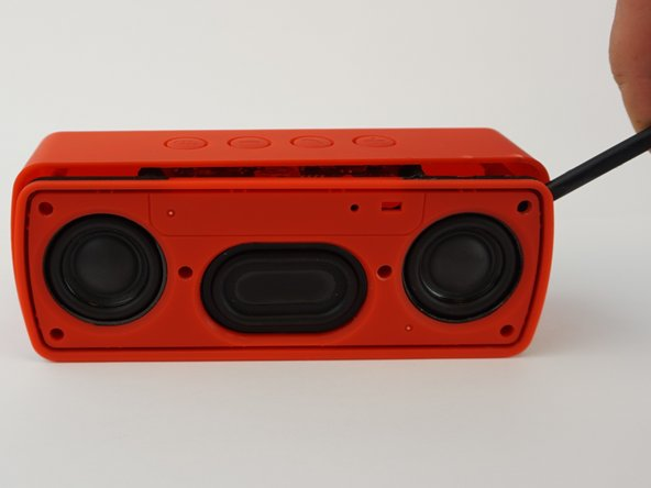 Image 1/2: Slide the spudger along the entire perimeter and gently pull off the face of the speaker.