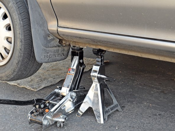 Image 1/3: Remove the jack stand from under the car.