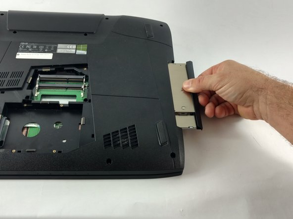 Pull out the optical drive located on the side of the laptop.
