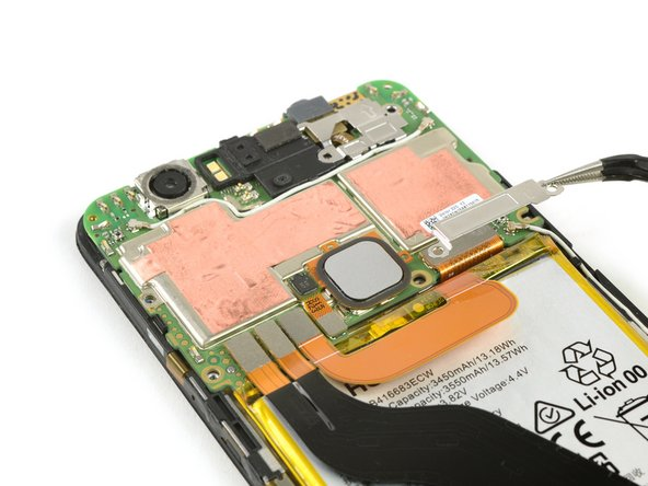Use tweezers to remove the metal shields covering the battery/main flex cable and the display flex cable.