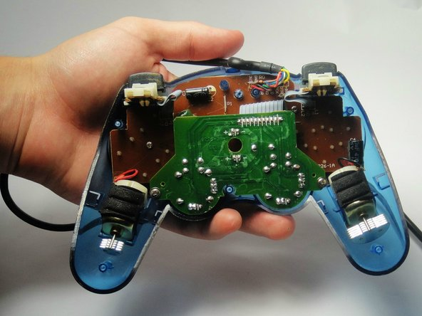There are no loose items in the controller that can fall out, so you can open it, generally, however you want.