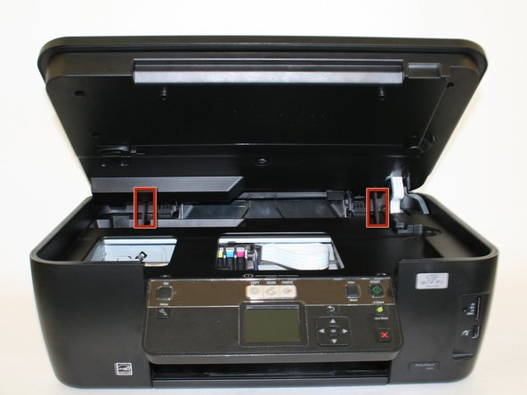 Raise and close the scanner unit to observe that the hinges lock in place when lifted.