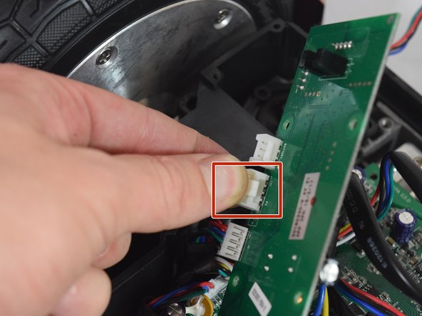 Remove the middle connector by squeezing the top of the tab and pulling up.