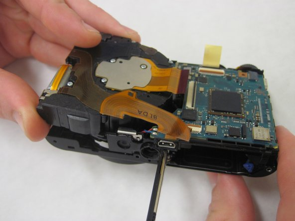 Carefully remove the lens assembly from the camera.