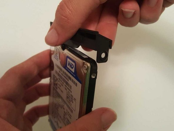 Pull the cover off of the hard drive to separate.