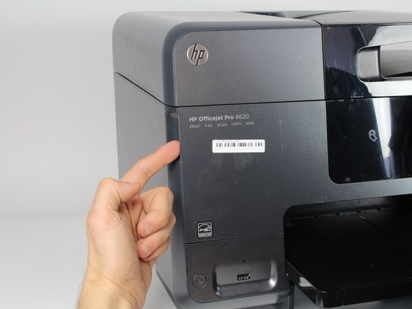 Open the front door by placing your finger on the indented groove on the left side of the printer and pulling down