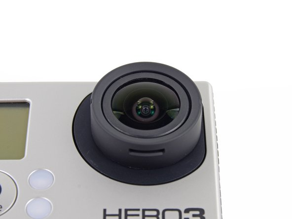 Image 1/3: To our dismay, we could not examine the deep dark innards of the Hero3 through the lens. Time to crack it open!