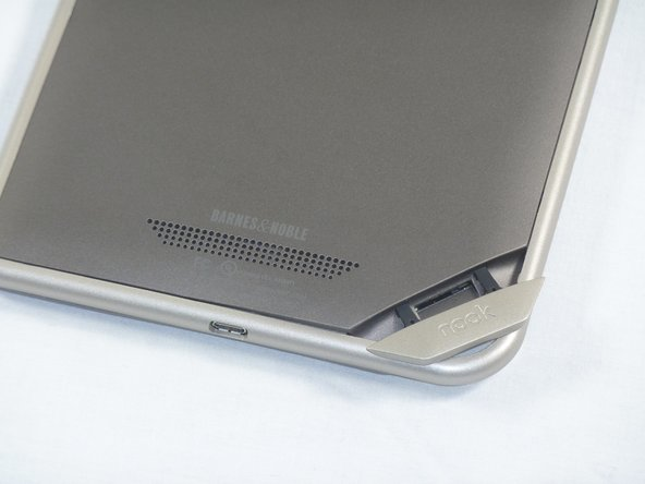 "Lift the flap that reads ""Nook"" to reveal the tape that is underneath. Remove the memory card if one is present."