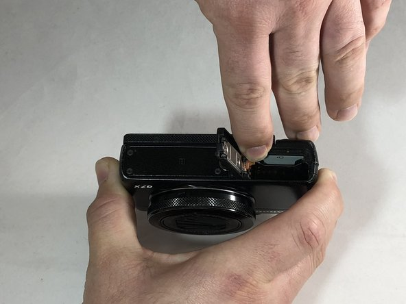 Slide the Light Brown latch with finger towards the screen.