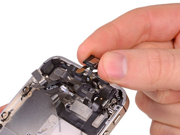 Lift and remove the power and sensor cable assembly from the iPhone.