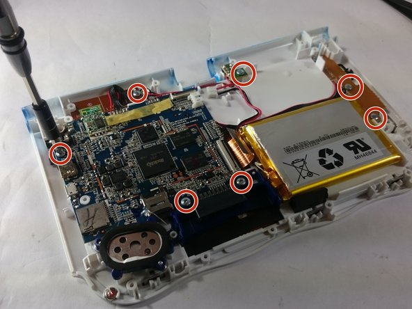 Remove the circled screws that are holding down the motherboard and components.