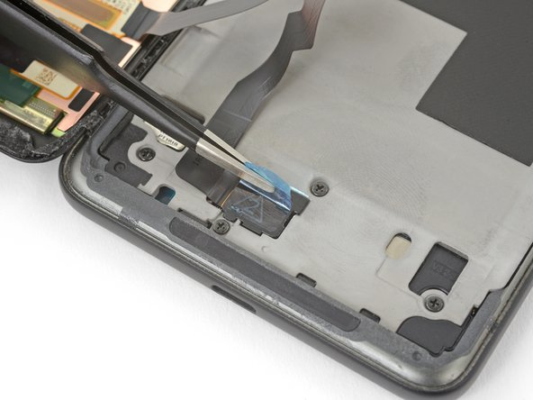 Use tweezers to remove any tape from the display connector cover.