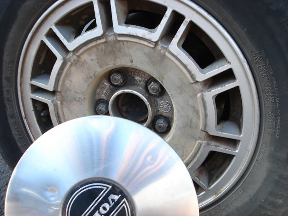 Pull hubcaps away from tires.