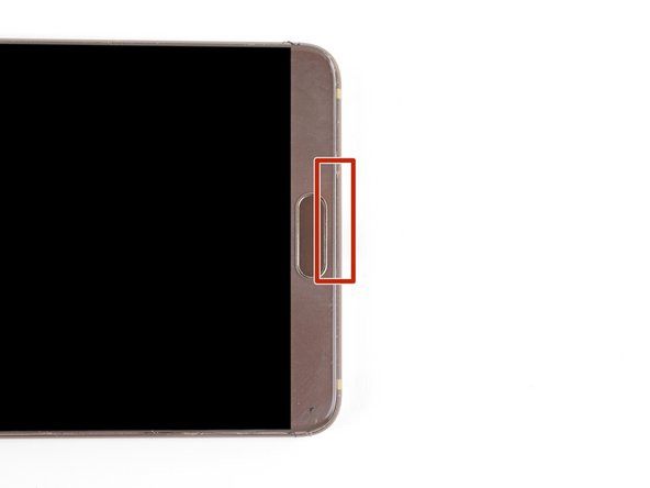 As you slice through the bottom edge, be careful not to slice near the right edge of the fingerprint sensor. It contains the sensor ribbon, which is prone to damage.
