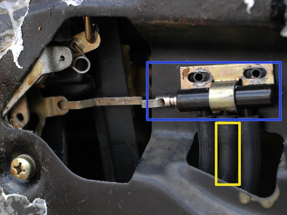 Inside your driver's door you will not find an actuator. Instead, there is a master vacuum switch that controls the actuators in the other three doors. In this picture, it is shown with the two Phillips head screws that hold its bracket in place already removed.