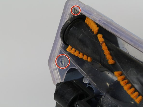Remove the two screws on the left side of the brush.