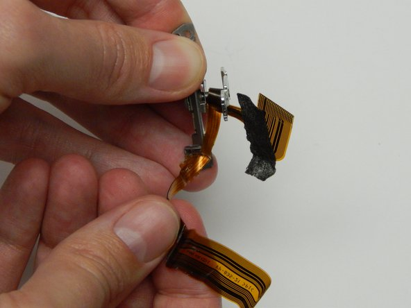 The flex cable is tightly wound around a metal rod in the center of the assembly.
