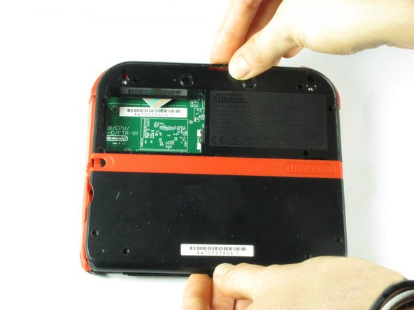 Image 1/1: Carefully pull the rear panel straight up from the device.