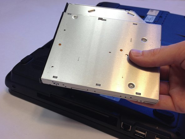 Once the disk drive becomes loose, slowly slide it out and set it aside.