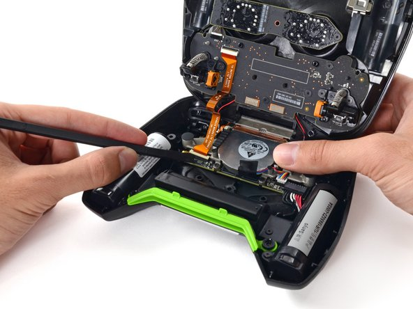 Image 1/2: The flick of a spudger and a few connectors are all that you need for button panel assembly disassembly.