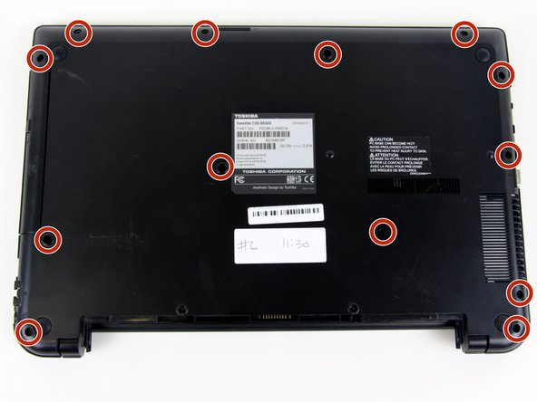 Remove the remaining thirteen 7 mm screws on the back panel of the laptop with a Phillips #0 screwdriver.
