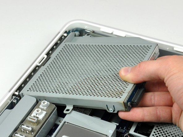 Image 3/3: Lift the optical drive out of your iMac.